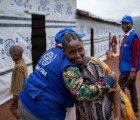 A member of the displaced community greets an IOM shelter expert. Credit: Olivia Headon / IOM