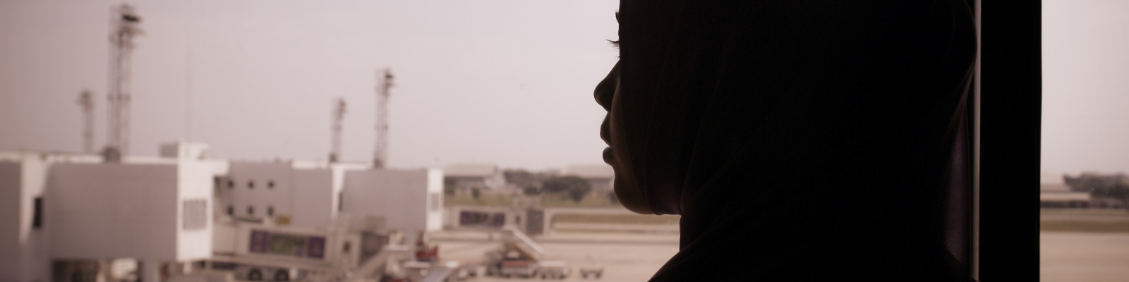 Muslim woman silhouette at the airport