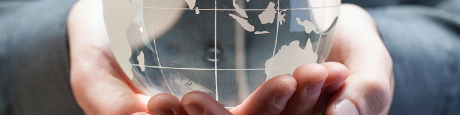 Translucent globe in hands image by Bill Oxford/Unsplash