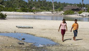 Kiribati youth on the sand